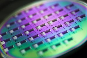 A silicon wafer is pictured during the media presentation of the Guardian Angels project in one of the low particle pollution nanofabrication clean rooms of the Swiss Federal Institute of Technology in Ecublens